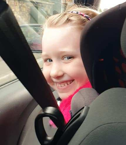 Young girl smiling in car