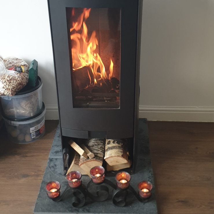 Woodburner logs candles lit