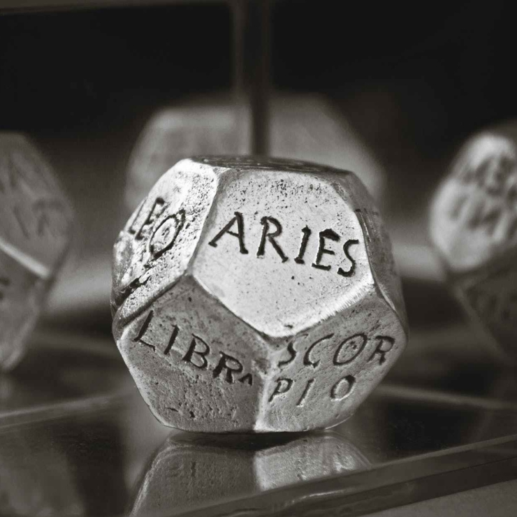 astrology dice in gray scale photography