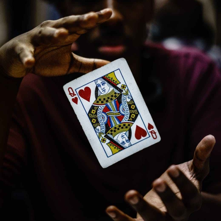 Queen Card midair