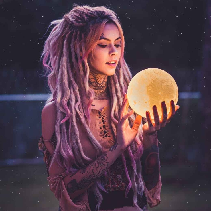Woman hippie holding Moon