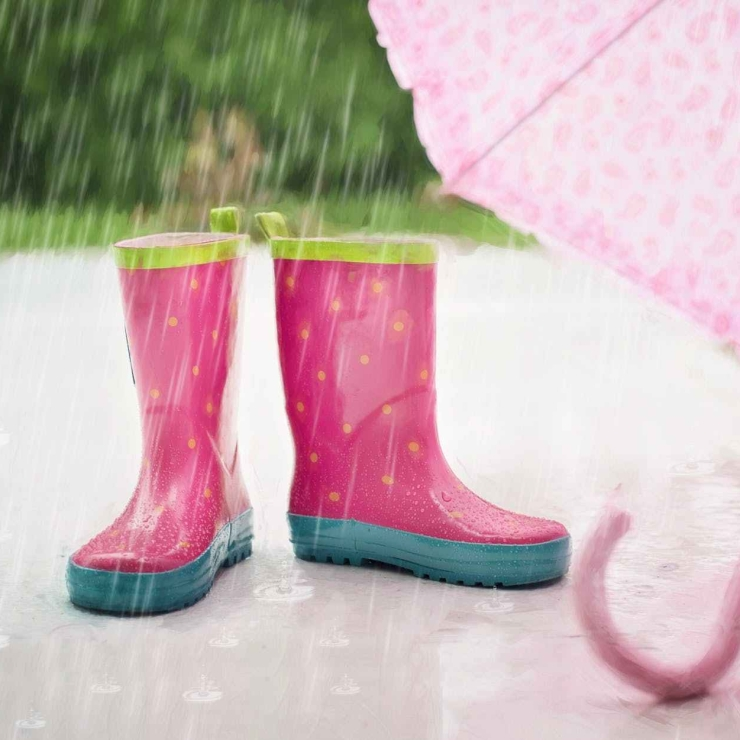 red and gray rain boots near pink umbrella